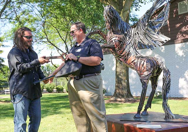 Local Sculptor, Greg Mendez received Key to the City